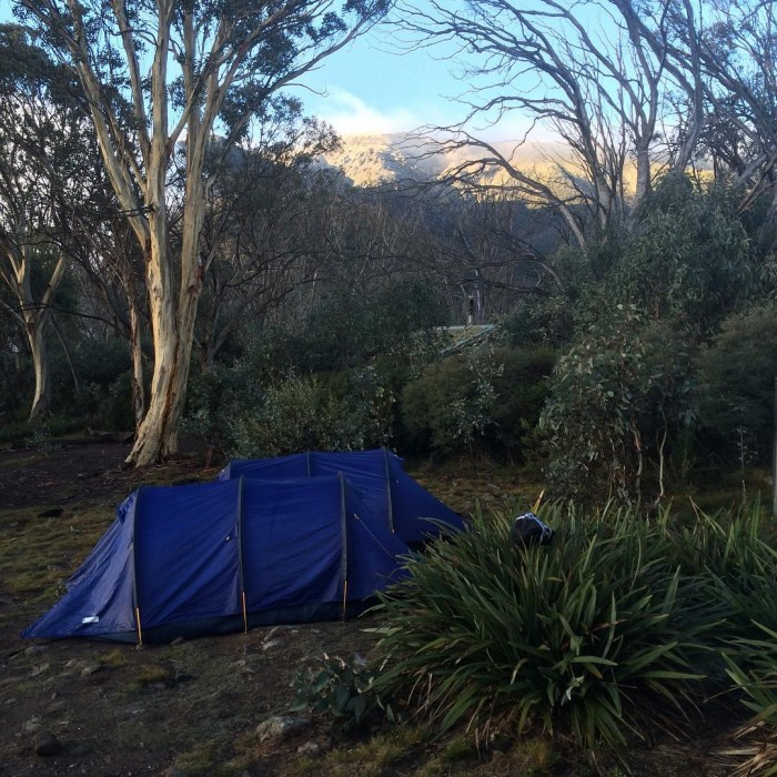 Bivouac hut looking up to a snowy Mt Bogong